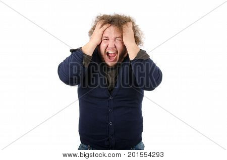 Rage, anger, irritation. Man shouts. Stress and Crisis. Headache. Man on a white background holding head and crying.
