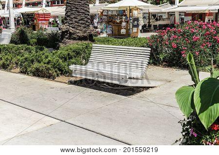 SPLIT, CROATIA - 12 JULY, 2017: White bench in the center of Split, Croatia