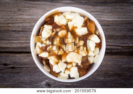 Poutine Quebec fastfood meal with french fries cheese curd and gravy