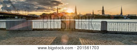 Sunrise above medieval buildings in historical center of old Riga, Latvia, Europe