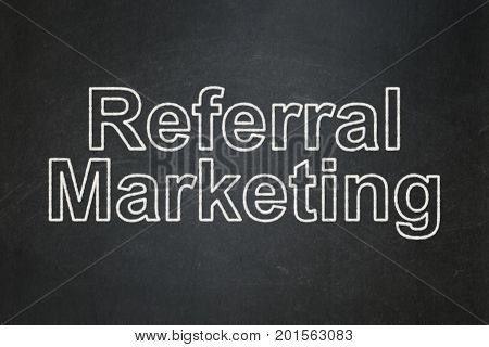 Marketing concept: text Referral Marketing on Black chalkboard background