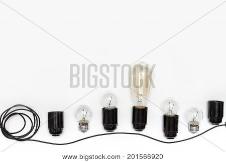 Retro light bulb, cartridges and wires for retro garlands on a white background isolated. View from above.