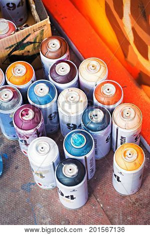 Colourful aerosol spray paint cans by graffiti painting, Dublin, Ireland, 27 August 2017