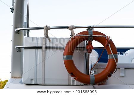 Lifeline on the ship. Red lifeline tied the railing of the ship.