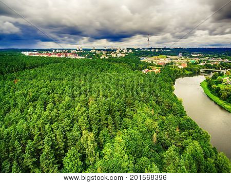 Vilnius, Lithuania: aerial UAV top view of Neris river and park in Bukciai in the summer