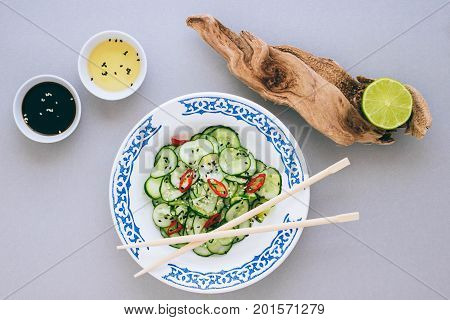Asian salad and cucumber with sesame seeds dressed with rice vinegar lime and sesame oil