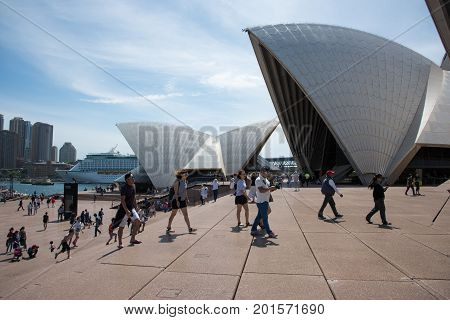 SYDNEY,NSW,AUSTRALIA-NOVEMBER 20,2016: Tourists and the unique rooftop design of the Sydney Opera House with cruise ship in Sydney, Australia.