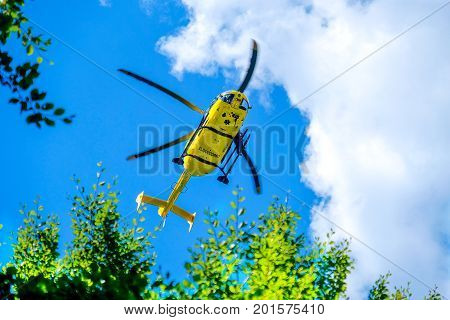 Modena 27 Aug 2017: an italian Elisoccorso ( helicopter rescue medical service ) yellow helicopter used for mountain rescue