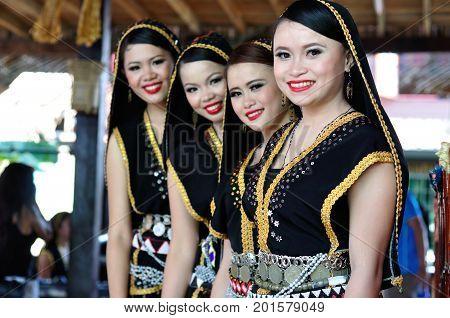 Kota Kinabalu , Malaysia - May 30, 2014: Beautiful Dancers Of Kadazan Dusun Ethnic From Ranau, An In