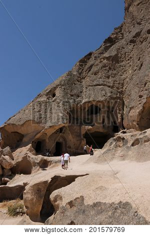 24th JULY 2017, CAPPADOCIA, TURKEY: Tourists visiting the Selime Monastery in Cappadocia, which is one of the largest religious buildings in Cappadocia. 2017
