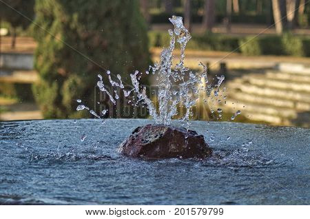water spurt from a fountain in the park