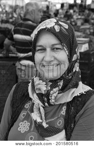 CALIS, TURKEY - 6TH AUGUST, 2017:A portrait of a turkish lady working at a fresh fruit and vegetable produce market in Calis, Turkey, 6th august 2017