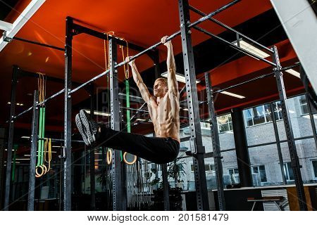 Bar Exercises. Workout In Dark Gym