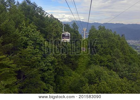 Ski lift in the mountains carrying passengers to hiking trails in summer in Japan Alps where hikers and climbers begin their mountaineering quests