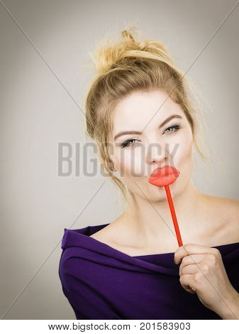 Funny Woman Holding Big Red Lips On Stick