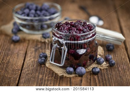 Portion Of Blueberries (preserved) On Wooden Background, Selective Focus