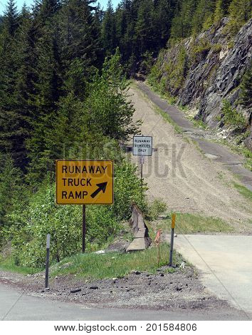 Runaway truck ramp in the forest on a mountain road, designed to slow down a vehicle and help prevent accidents if a commercial truck loses braking or loses control down a steep hill.