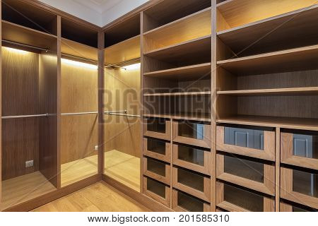 An empty wardrobe made of wood, for the family.