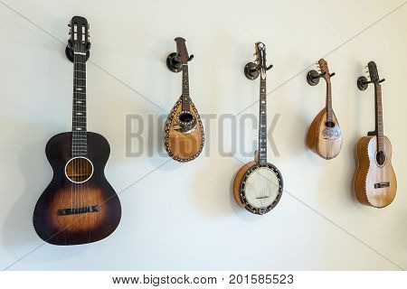 Ancient stringed musical instruments on the wall.