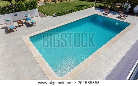 Modern swimming pool for tourists, in the garden.