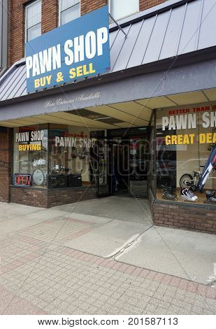 CADILLAC, MICHIGAN / UNITED STATES - MAY 31, 2017: One may pawn one's belongings at Better than a Pawn Shop, on Mitchell Street in Downtown Cadillac.