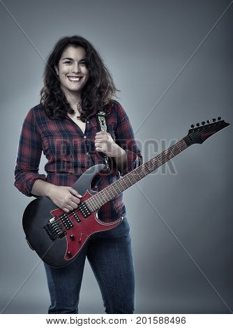 Latino woman singer with an electric guitar