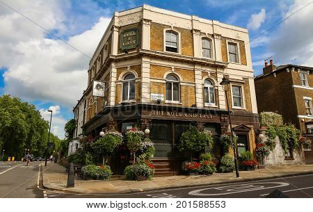 LONDON, UK - AUGUST 14, 2017:The Bull and Last is an historic pub housed in a 19th century coaching inn in Hampstead Heath in leafy north west London.