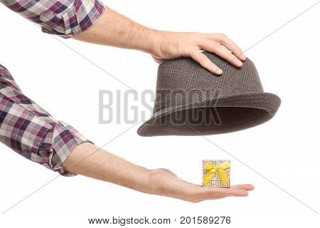 A hat with a gift box of a man's hand on a white background isolation