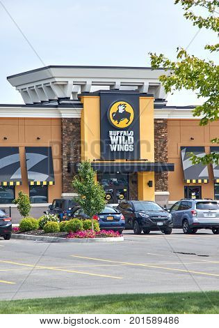 PLATTSBURGH USA - AUGUST 23 2017 : Buffalo Wild Wings restaurant and logo. Buffalo Wild Wings is an American casual dining restaurant and sports bar franchise