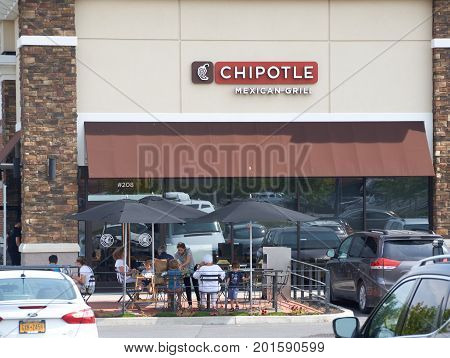 PLATTSBURGH USA - AUGUST 23 2017 : Chipotle restaurant and logo. Chipotle Mexican Grill Inc is an American chain of fast casual restaurants in the United States