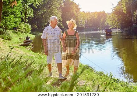 Couple of seniors, summer. Man and woman near water. People enjoying retirement.