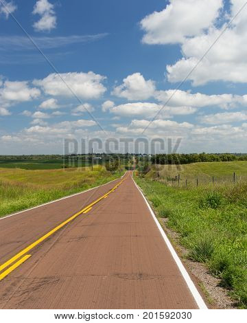 Long and hilly country road on a sunny day