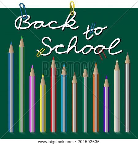 back to school white text with paper clips on green chalkboard - pencils set twelve colored crayons and shadow