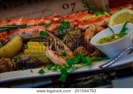 Crab boil with shrimp, potatoes, corn, and tarragon butter