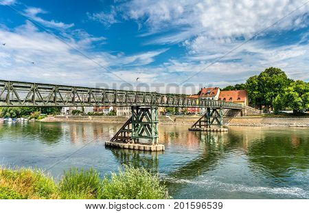 Eiserner Steg bridge across the Danube River in Regensburg - Bavaria, Germany
