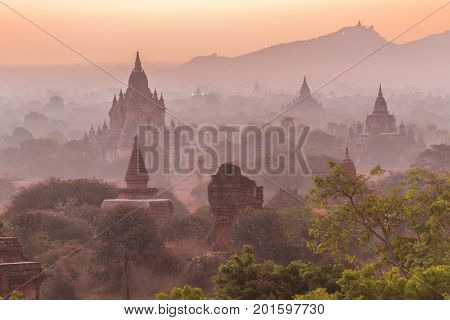 Beautiful misty sunrise over old pagodas of an ancient city of Bagan, Myanmar
