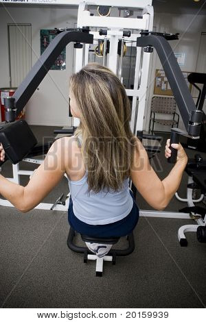 lady with long hair at the gym