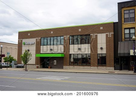 CADILLAC, MICHIGAN / UNITED STATES - MAY 31, 2017: The Huntington Bank offers banking services on Mitchell Street, in Downtown Cadillac.