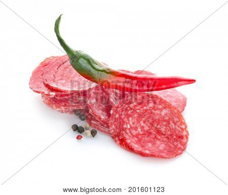 Delicious sliced sausage with chili pepper and spice on white background
