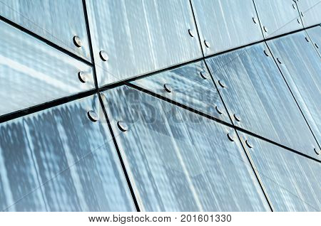 Spider facade fixing system. Elements of fastening of the facade. Facade detail. Chaotically located elements of the glass facade. Abstract Architecture Background