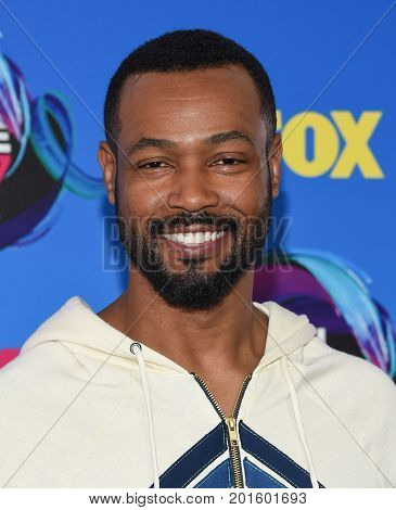LOS ANGELES - AUG 13:  Isaiah Mustafa arrives for the Teen Choice Awards 2017 on August 13, 2017 in Los Angeles, CA