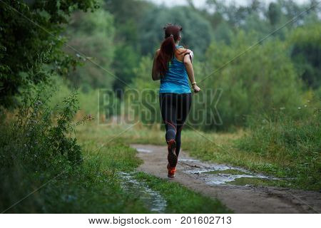 Running girl in summer woods