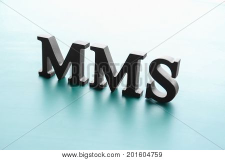 Management abbreviation MMS made with letters on light background