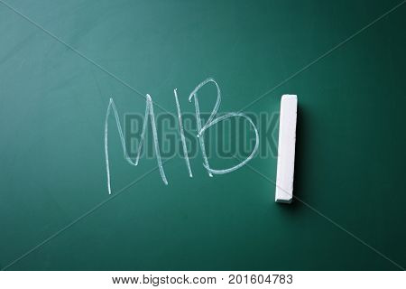 Management abbreviation MIB written on chalk board
