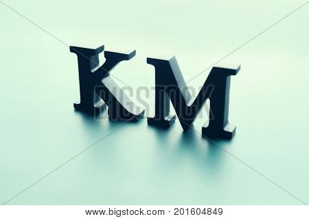Management abbreviation KM made with letters on light background