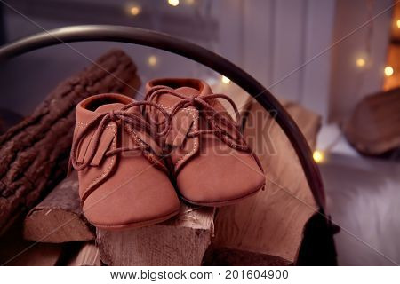 Baby booties on firewood. Christmas concept