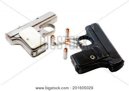 Two guns and and .23 caliber bullits. Isolated on a white background.