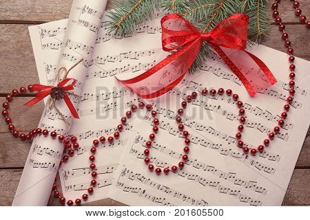 Beautiful composition with decorations on music sheets. Christmas songs concept
