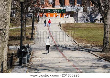 Boston Massachusetts USA - March 9 2008: Runner tackles the hill to Beacon Street on Boston Common on a late winter morning
