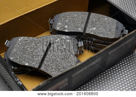 Front wheel disc brake pads in a box